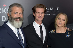 "BEVERLY HILLS, CA - OCTOBER 24: (L-R) Director Mel Gibson, actors Andrew Garfield, and Teresa Palmer attend the screening of Summit Entertainment's ""Hacksaw Ridge"" at Samuel Goldwyn Theater on October 24, 2016 in Beverly Hills, California. (Photo by Matt Winkelmeyer/Getty Images)"